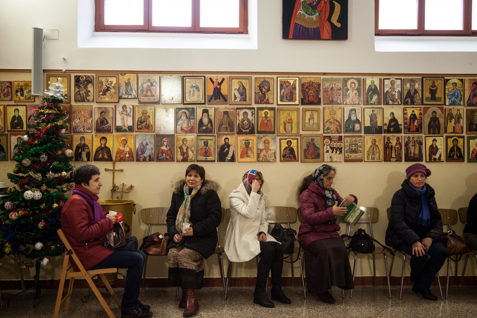After Sunday celebration, some women sit in the Romanian Orthodox Church in Quadraro, a working class neighborhood in southeaster Rome.