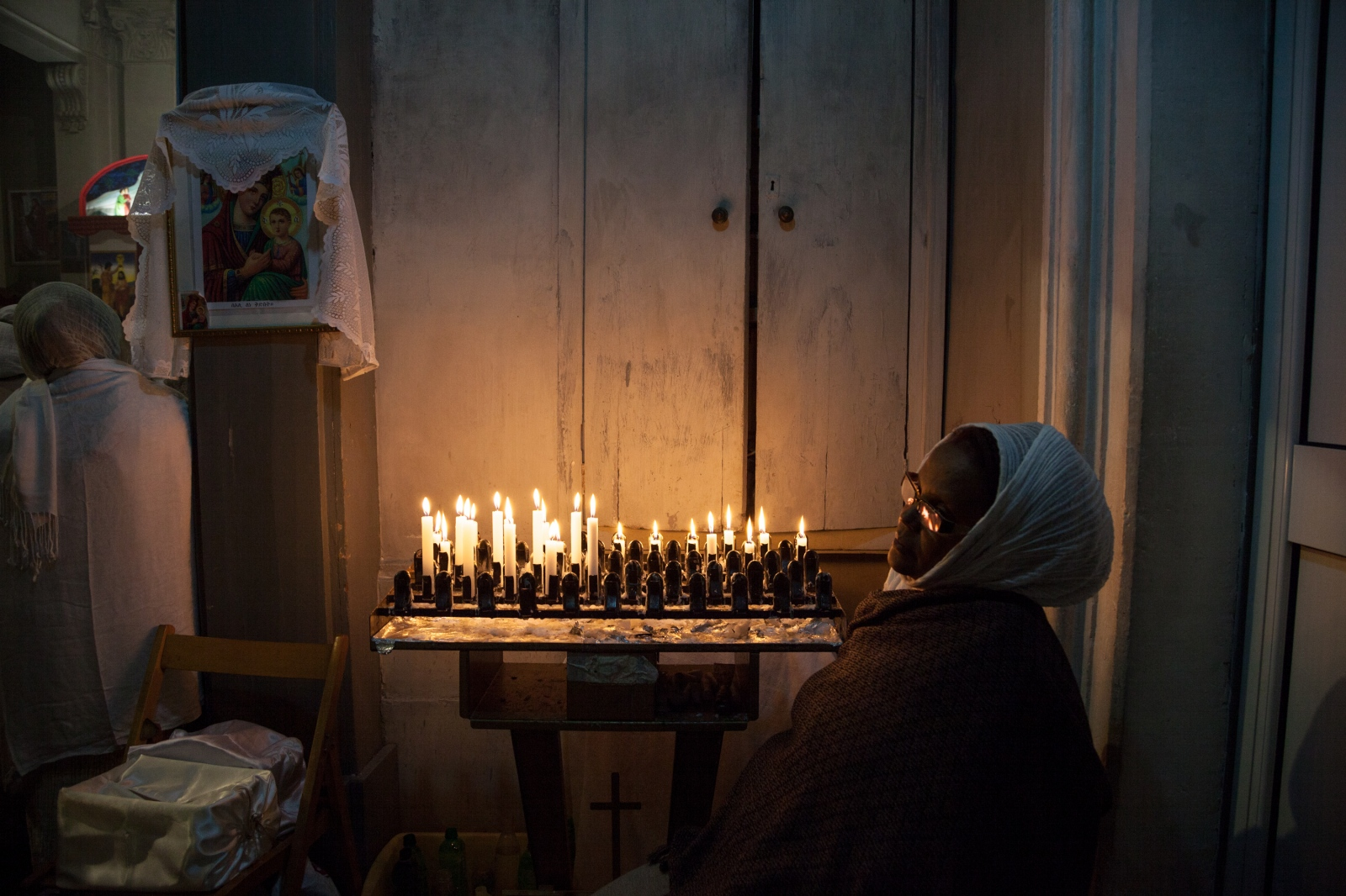 Inside the Eritrean Orthodox Tewahdo Church in Piazza San Salvatore in Campo, downtown Rome, a woman takes part to the celebration for Orthodox Christmas Day.