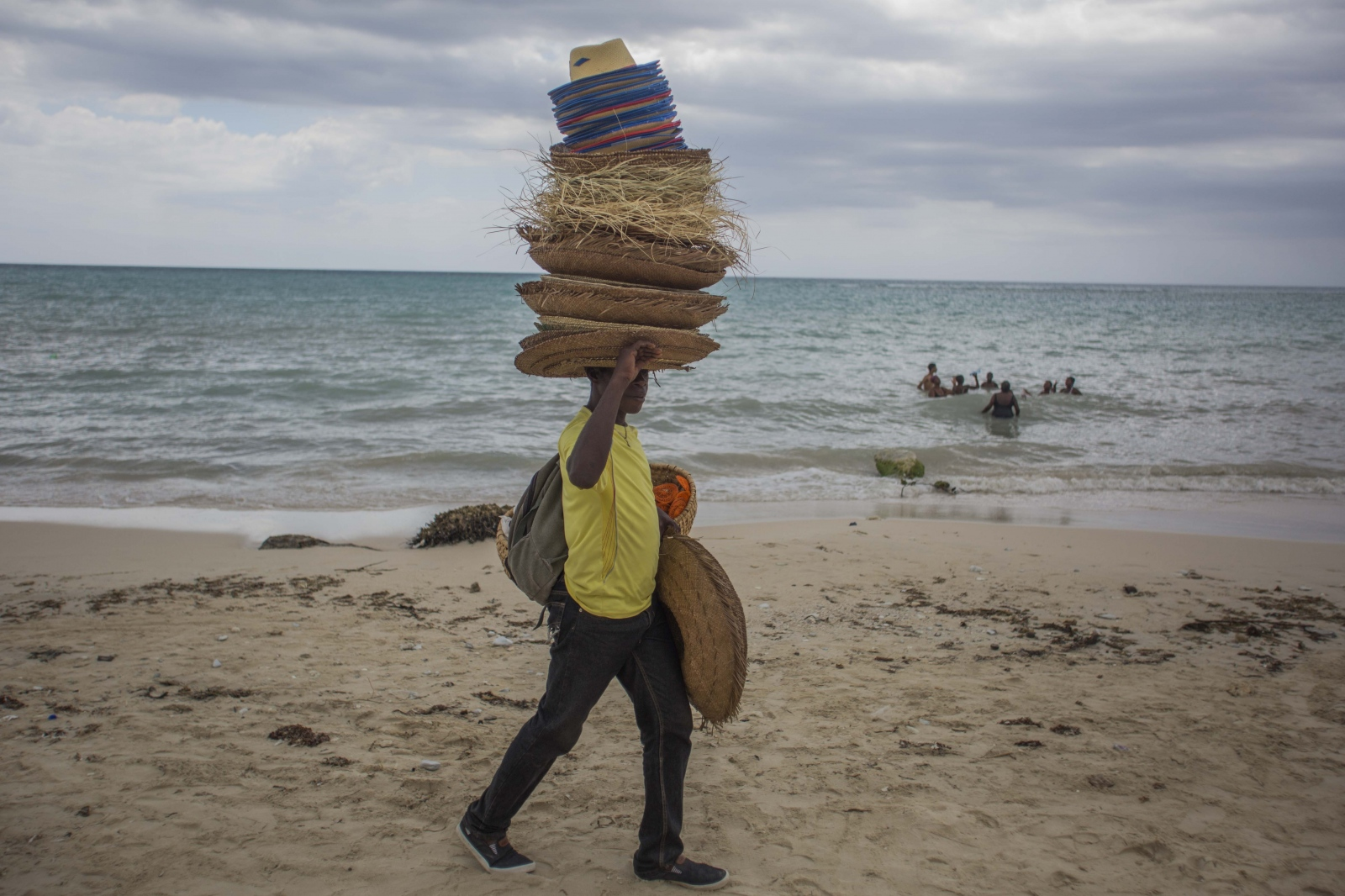 A hat seller at the beach in Port-Salut. Cayes,...