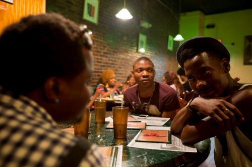After the Bloom Global Pride Party, Saheed Ipadeola, Michael Ighodaro, and Williams Rashidi go for a late dinner. They avidly discuss Nigerian politics and news.  Though Saheed and Michael now call the United States their home, they are passionately vocal against the Nigerian government as LGBT activists. Harlem, New York, June, 2014.
