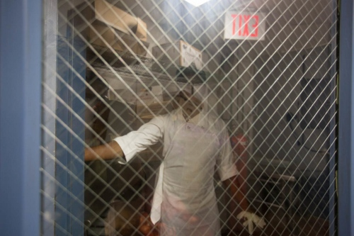 While Saheed waits to gain asylum, he works as a kitchen porter in a hotel in Brooklyn, New York, August, 2014.