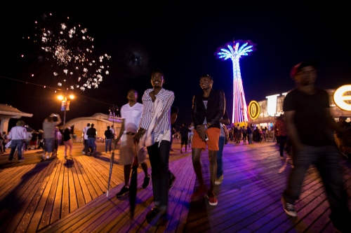Michael Ighodaro, Williams Rashidi and friends at the Coney Island Boardwalk during the fourth of July fireworks display. Though the numbers haven't been formally tracked, immigration equality advocates say that LGBT Nigerians, especially gay men, are increasingly looking to the United States for asylum. The exit of LGBT people seeking asylum from countries like Nigeria and Uganda, that have intolerant laws is unprecedented. Coney Island, New York, July, 2014