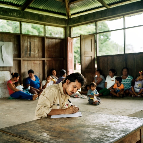 Luis Felipe Torres, the head of the state's isolated tribes team, prepares for a meeting in Diamante, a indigenous Yine community that has frequently interacted with the Macho Prio.