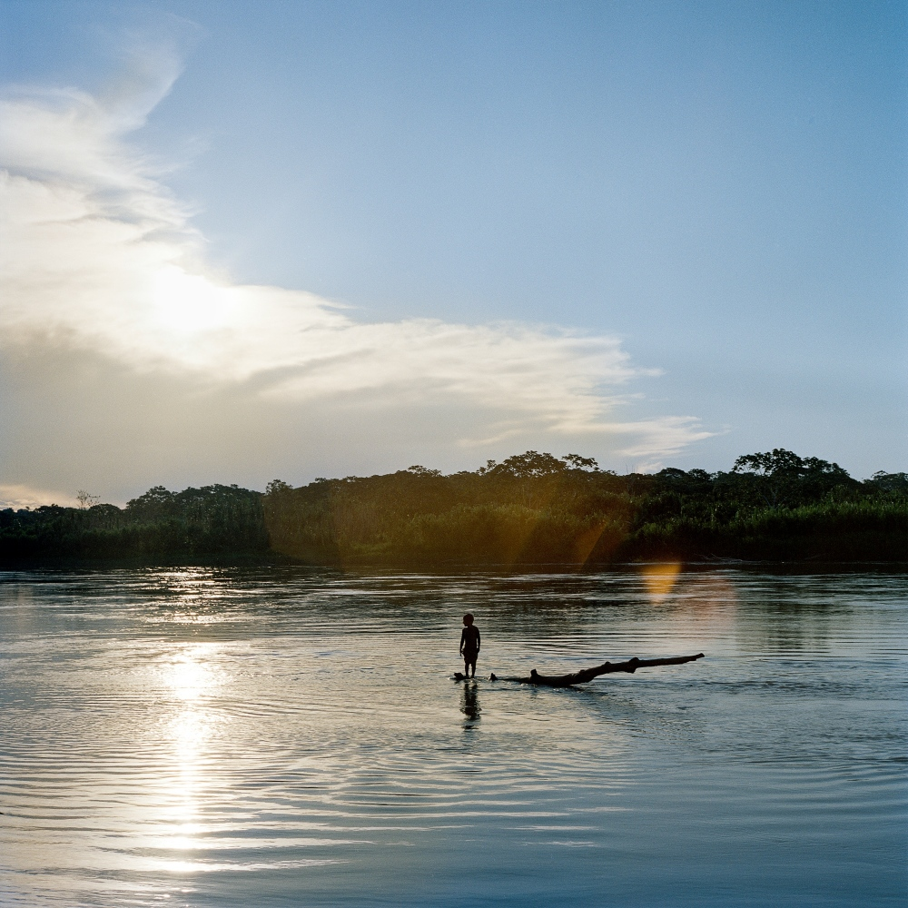 A boy from the Yine town of Diamante swims on the Madre de Dios river. Diamante is an indigenous community that has frequently interacted with the Mashco-Piro as they speak a similar language