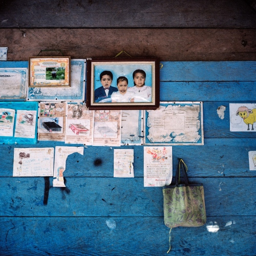A photograph of the grandchildren of Alberto Flores, a Mashco-Piro indigenous who was kidnapped by Machiguenga hunters as a child, hangs on the wall of his home in Diamante, an indigenous Yine town on the Madre de Dios River.