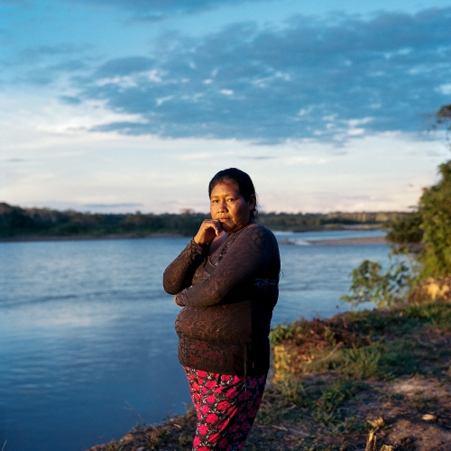 Nelly Florez, 38, who works as a protection agent, overlooks the beach on the Madre De Dios River where the Mashco-Piro come out to meet the government workers from the Namole outpost. She is the daughter of a Macho Piro man, Alberto Flores, who was kidnapped as a child and raised in the village of Diamante.