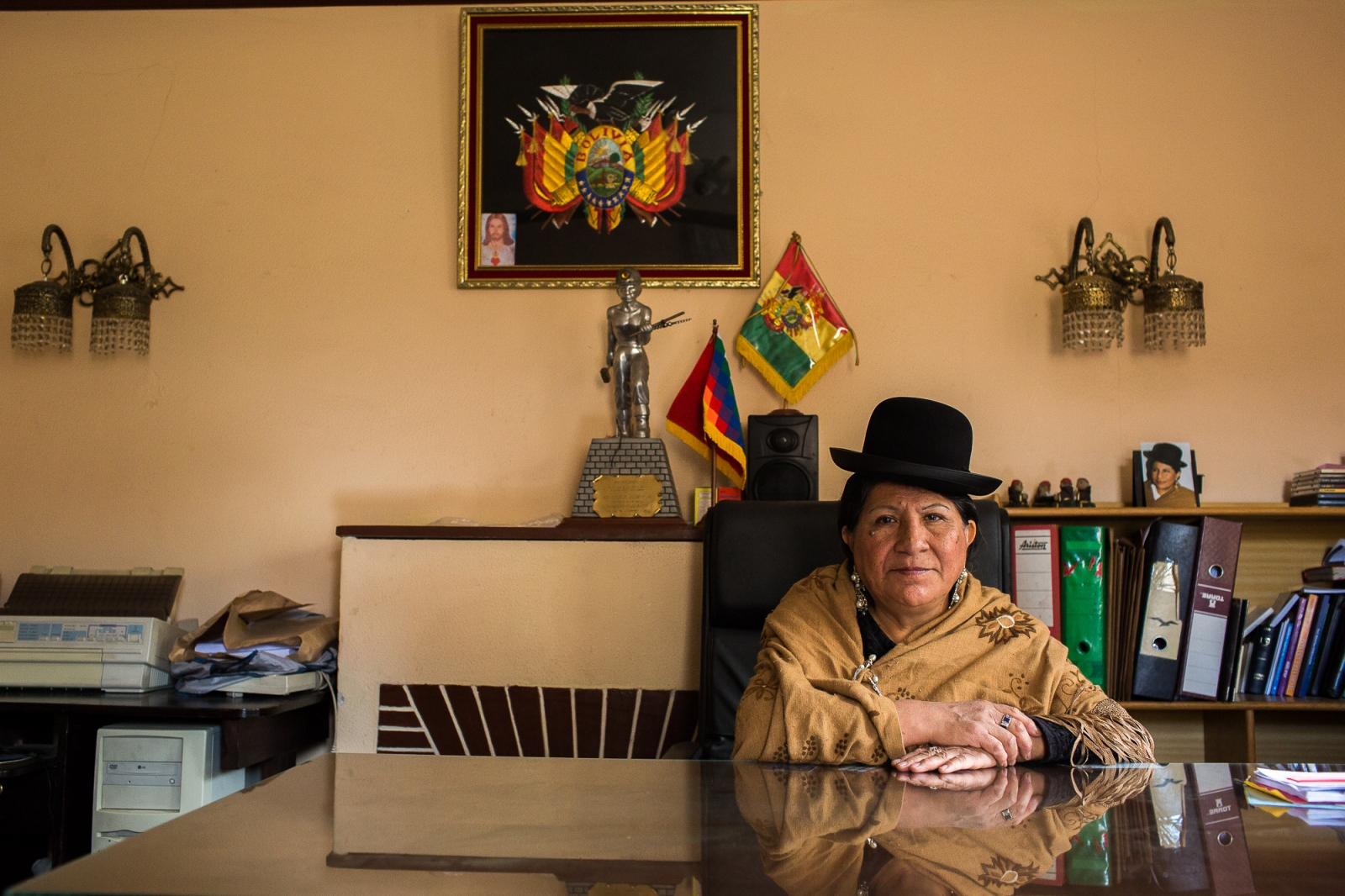 "Remedios Loza in her office at Radio Andina in La Paz. Comadre Remedios as Loza is known as a pioneer for ""cholitas' rights."" In 1962, she became the first indigenous woman to have radio and TV programs, and she used these platforms to give voice to the indigenous and to poor people. In 1989, she became the first indigenous woman to have a seat in Bolivia's Plurinational Legislative Assembly. In 1997, she became the first woman to ever run for Bolivia's presidency. She came in third; but fewer than 10 years later, her movement helped elect Evo Morales as the country's first indigenous president."