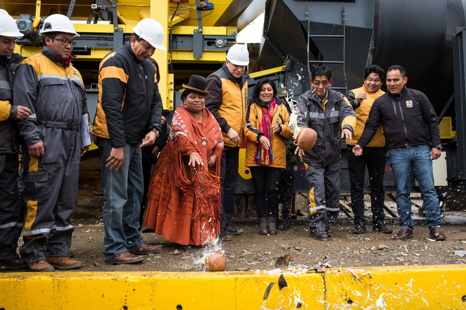 Alderwoman Reveca Sangali and Mayor Soledad Chapeton baptize an asphalt plant in El Alto. After 15 years of abuse—during which Reveca often had to sell merchandise on the streets in order to feed her six children—and an attempt on her life, she left her husband with the children and restarted her life. Through a friendship with the mayor, Reveca slowly became involved with politics, and in 2015 she was elected to a municipal office.