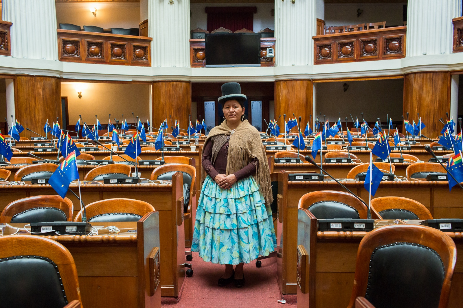 Congresswoman Cristina Paxi at the Plurinational Legislative Assembly in La Paz. After hearing countless times that women couldn't be elected to high office, Paxi decided to prove that they could. She ran for a seat in the Legislative Assembly's Chamber of Deputies in 2014 and won. In truth, more than half of the Legislative Assembly's members are women, a proportion which is second only to Rwanda.