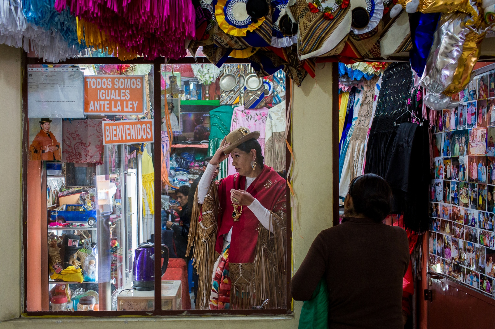 "Diana Malaga in her La Paz store. Diana is the first prominent transsexual ""cholita"" in Bolivian history, which means she has often had to fight against prejudice on two fronts. She says she embraced her cholita identity in honor of her grandmother, who was a cholita, too."