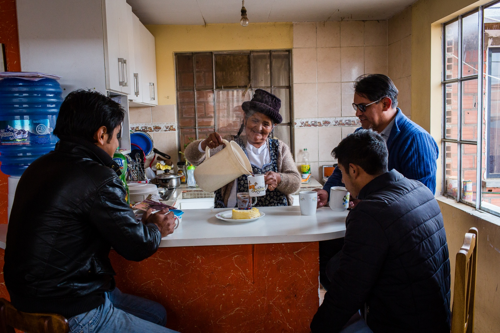 Catalina Silvera pours coffee during a meeting with three of her six sons at the Silvera furniture factory in El Alto. While Catalina's sons run the daily business, she still makes the major decisions.