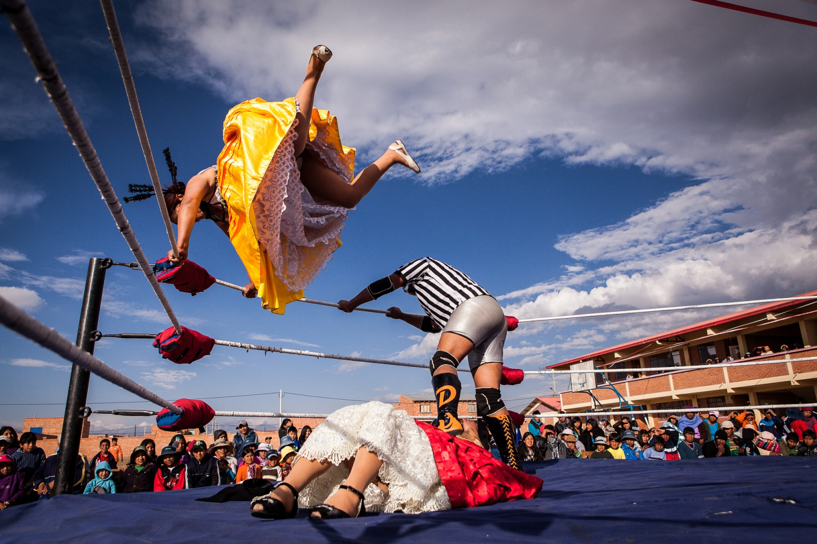 Silvina La Poderosa jumps from a corner of the ring to land on her opponent, Reyna Torres, during a promotional fight in Senkata, El Alto. After years of dwindling audiences, and in an attempt to revive public interest, wrestling finally allowed indigenous women to participate. The sport's popularity has since rebounded considerably.
