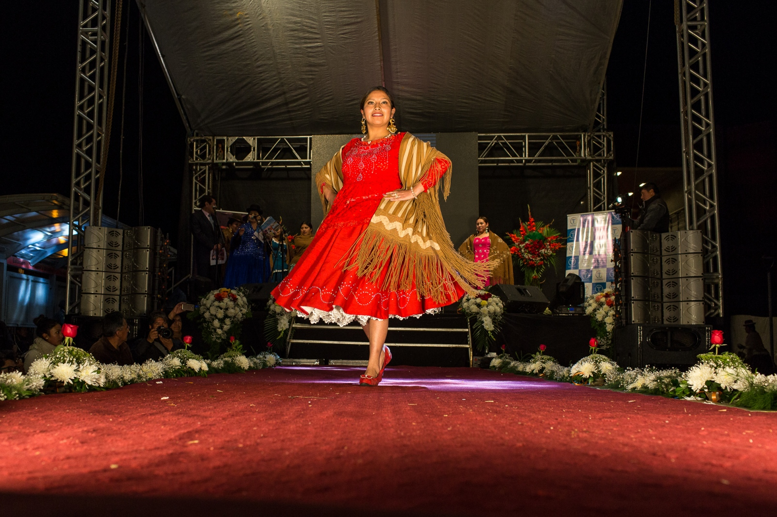 A model presents a fashion design on the catwalk during a fashion event in El Alto.
