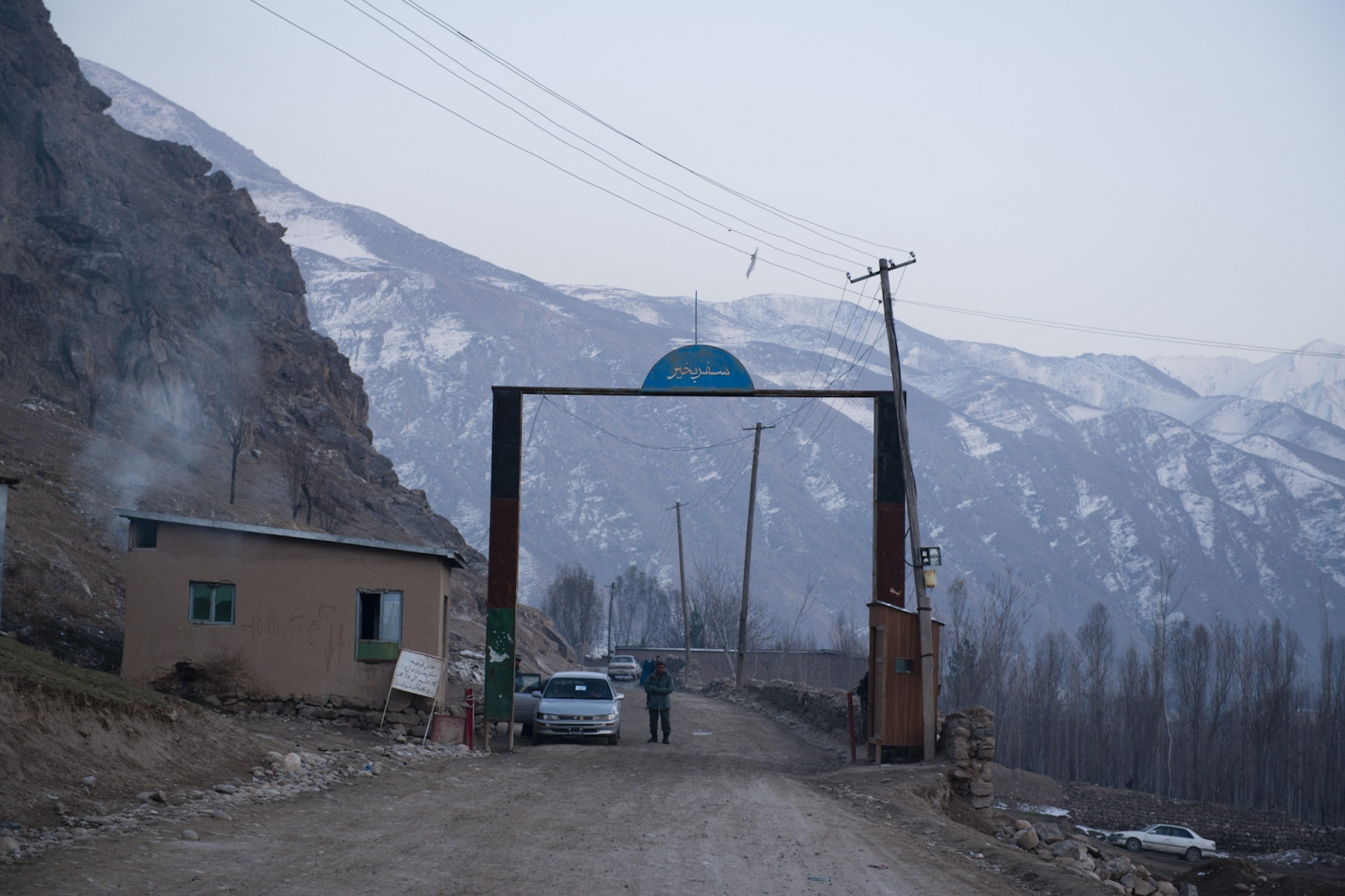 FAIZABAD, AFGHANISTAN | 2014-12-13 | The gate signifying the end of the town of Faizabad where drivers have to pass through to get to the Jorm district in northern province of Badakhshan.