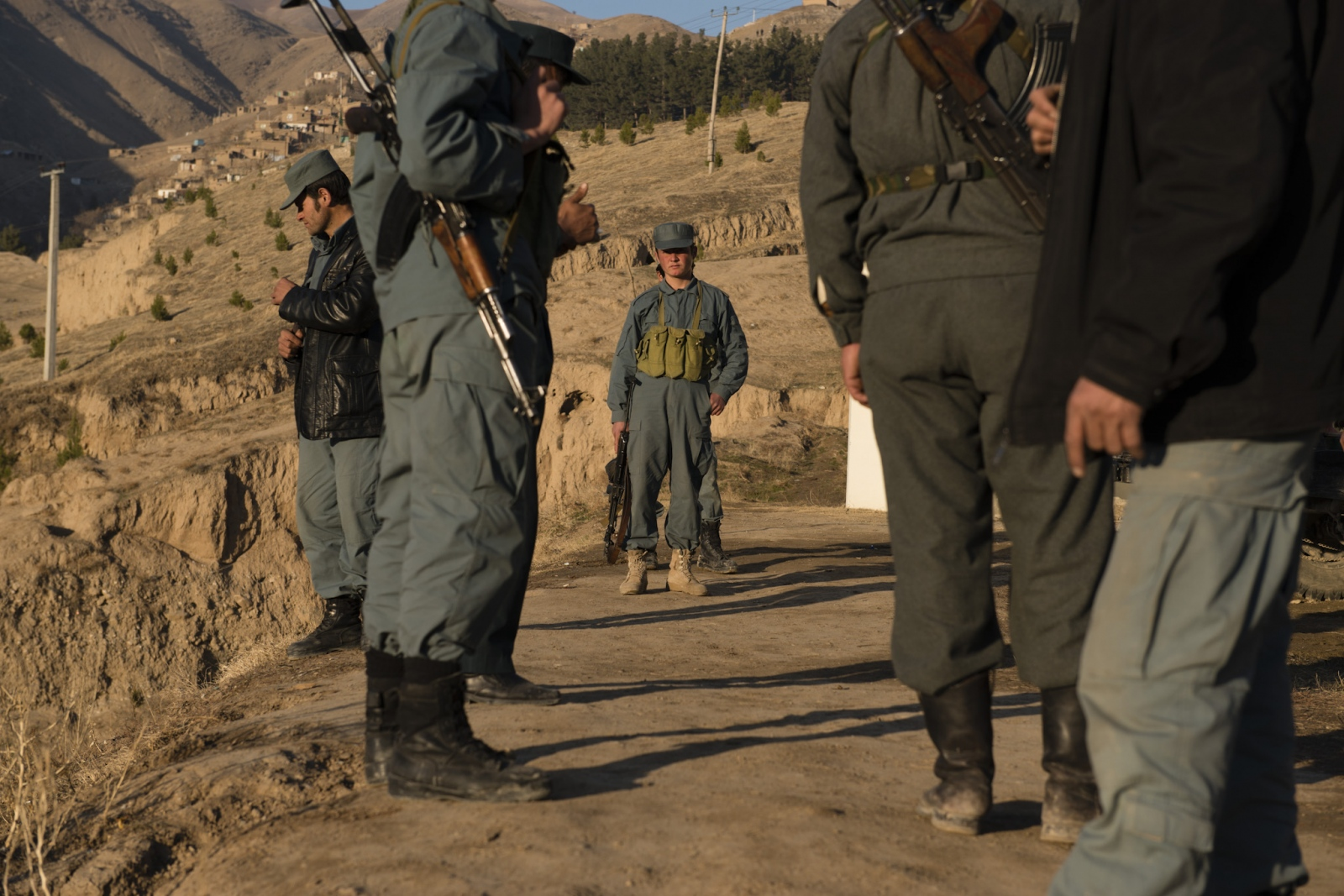 FAIZABAD, AFGHANISTAN | 2014-12-14 | At a police outpost just outside of the town of faizabad, a young policemen, highly suspected to be a minor, is seen on patrol, watching the city from the top of the hill. In the past 2 months, 24 members of AFP (Afghan Police Force) had been kidnapped by Taliban.
