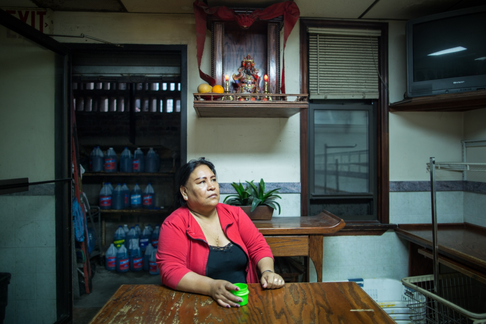 Every Thursday Juanita goes to the laundry on 56th Street and Third Avenue to wash the secondhand clothing that she sells every Friday and Saturday outside the church of St. Jacobi. Most times, her husband Carlos and children help her in the washing, ironing and put the clothes into hangers for sale. Sunset Park, Brooklyn, New York, 2016.