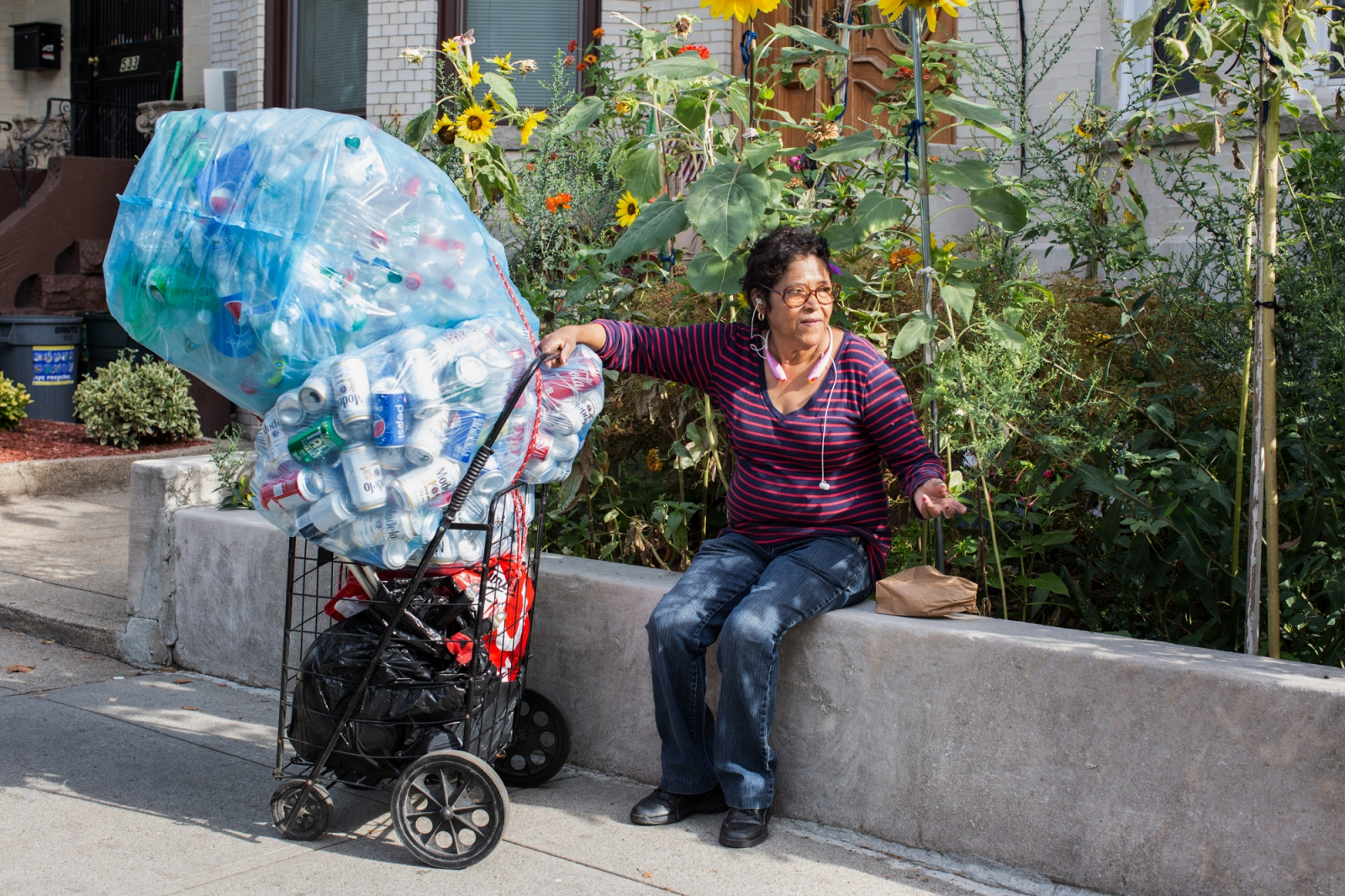 "Every two weeks Irma takes the plastic bottles that she collects in the streets, ""I do not earn much from the sale of the bottles, but at least I get the money to buy tortillas, bread, and milk. I also sell metal, that is a little more because it is sold by weight "" says Irma. Sunset Park, Brooklyn, New York. 2016"