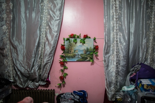Part of the decorations on the walls of the room where Dionisia sleeps and lives with her husband Nacho in Sunset Park, Brooklyn, New York, 2016.