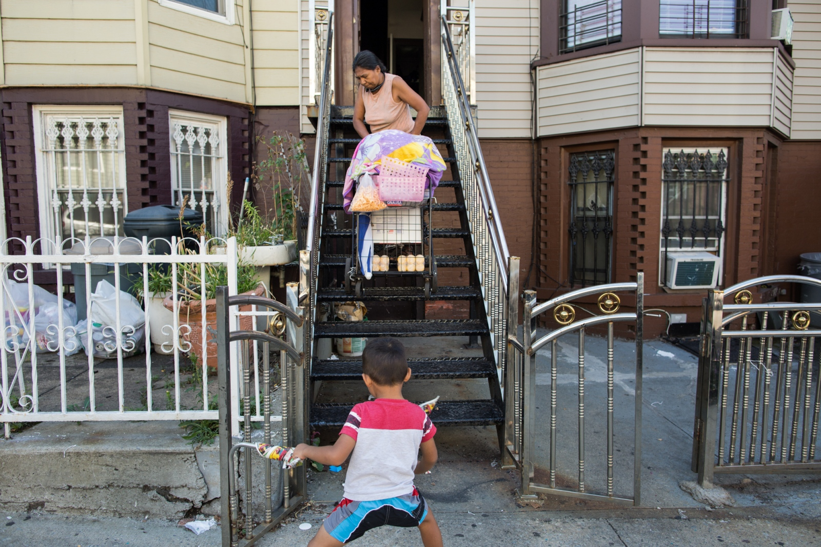 Dionisia Guadalupe leaving her apartment on 45th St. with her candy cart to sell across PS 503 in Sunset Park, Brooklyn, New York. 2016