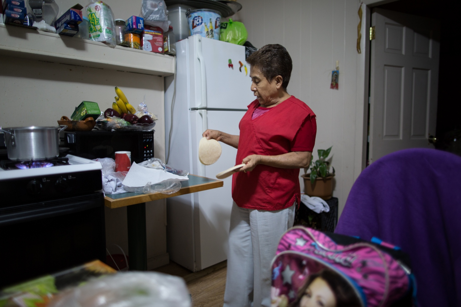 Gisela cooking a green mole at her house on 45th Street in Sunset Park, Brooklyn, New York, 2016.