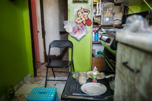 The kitchen of the Department of Dionisia, which she shares with her husband, her son Yoscart, her daughter-in-law, and grandchildren, Oscar and Akari, on 45th. Street in Sunset Park, Brooklyn, New York, 2016.