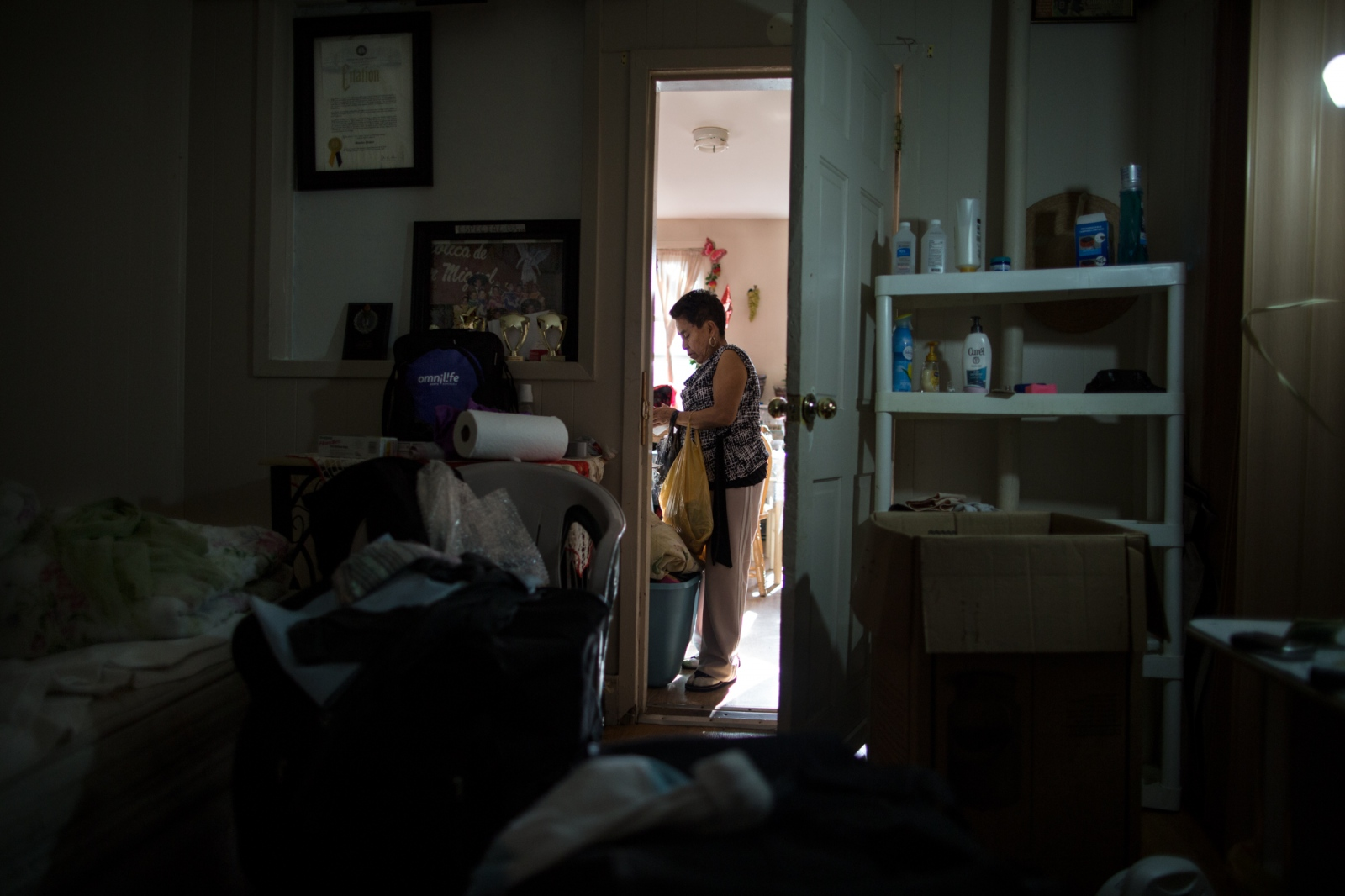 Gisela cleaning her house in Sunset Park, Brooklyn, New York, 2016.