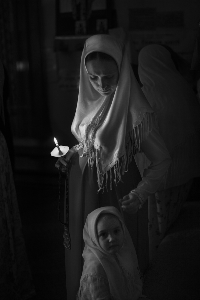 Efrosinia Yakunin, expecting a new baby, and daughter Tamara during the ceremony of Pascha conducted by her husband Deacon Vasily Yakunin.