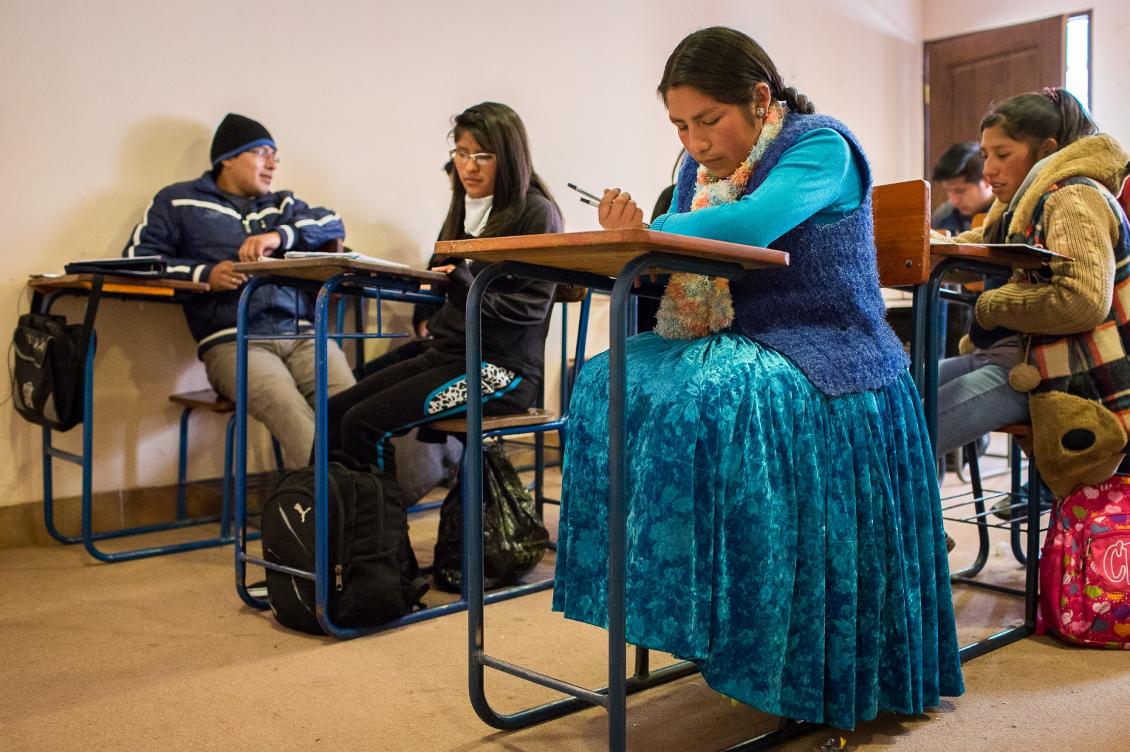 Elizabeth Ramos during a class of the History degree at El Alto Public University, El Alto. Elizabeth is the only Cholita taking the History degree. She is so admired by her colleagues that she was chosen as course representative.  Elizabeth faced sometimes discrimination for being an indigenous woman. After finishing her degree she wants to translate texts of history of her ancestors and put them in a book.