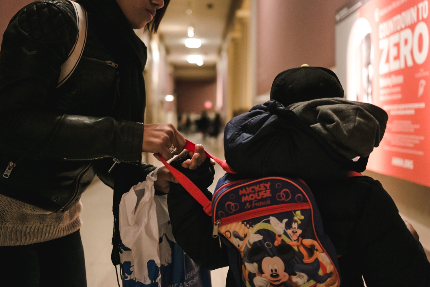 Art and Documentary Photography - Loading Espinosa24_Carlos__mother_prepares_his_bookbag_before_leaving_the_Museum_of_Natural_History_in_New_York_City.jpg