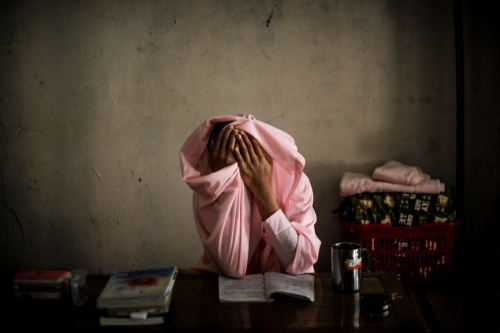 Nun is in prayer In Buddhist temple © Fatemeh Behboudi