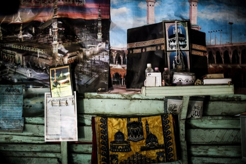 Many Muslims are poor and Their dream is Tripe to Mecca.In many Muslim houses You can see photos of Mecca and the Prophet Muhammad tomb. © Fatemeh Behboudi