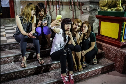 In The Chinese New Year young girls are taking pictures with each other © Fatemeh Behboudi