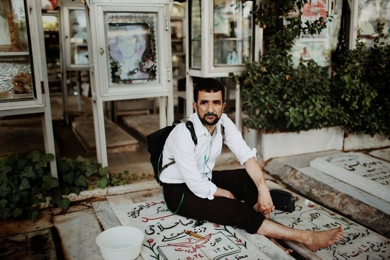 Saeed (47) is a chemical veteran of the war. He experienced two attacks of chemical bombs in different areas. Every week he goes to the graveyard of martyrs and washs the graves of all his martyred friends and spends time by them © Fatemeh Behboudi