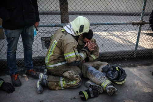 After the fall of the Plasco building, firefighters started their work in hopes of surviving the victims