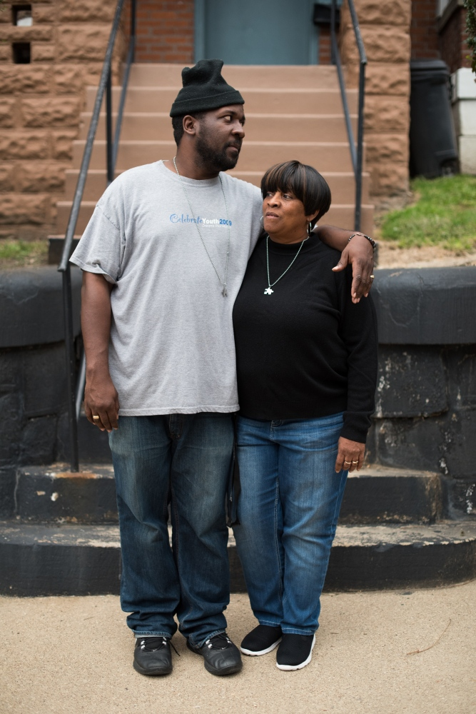 Ron Scott, Jr., a youth counselor and third- generation Wheeling resident, and his mother, Linda Scott, a nurse, pose for a portrait outside of Linda's home in East Wheeling. Ron's father was in and out of prison throughout his childhood, and his mother has served as a source of strength and inspiration throughout his life. The historic neighborhood of East Wheeling where Ron works has been hit hard by poverty and drugs but has in the last couple of years become a base for creatives, entrepreneurs and grass roots organizations looking to give the city new life.
