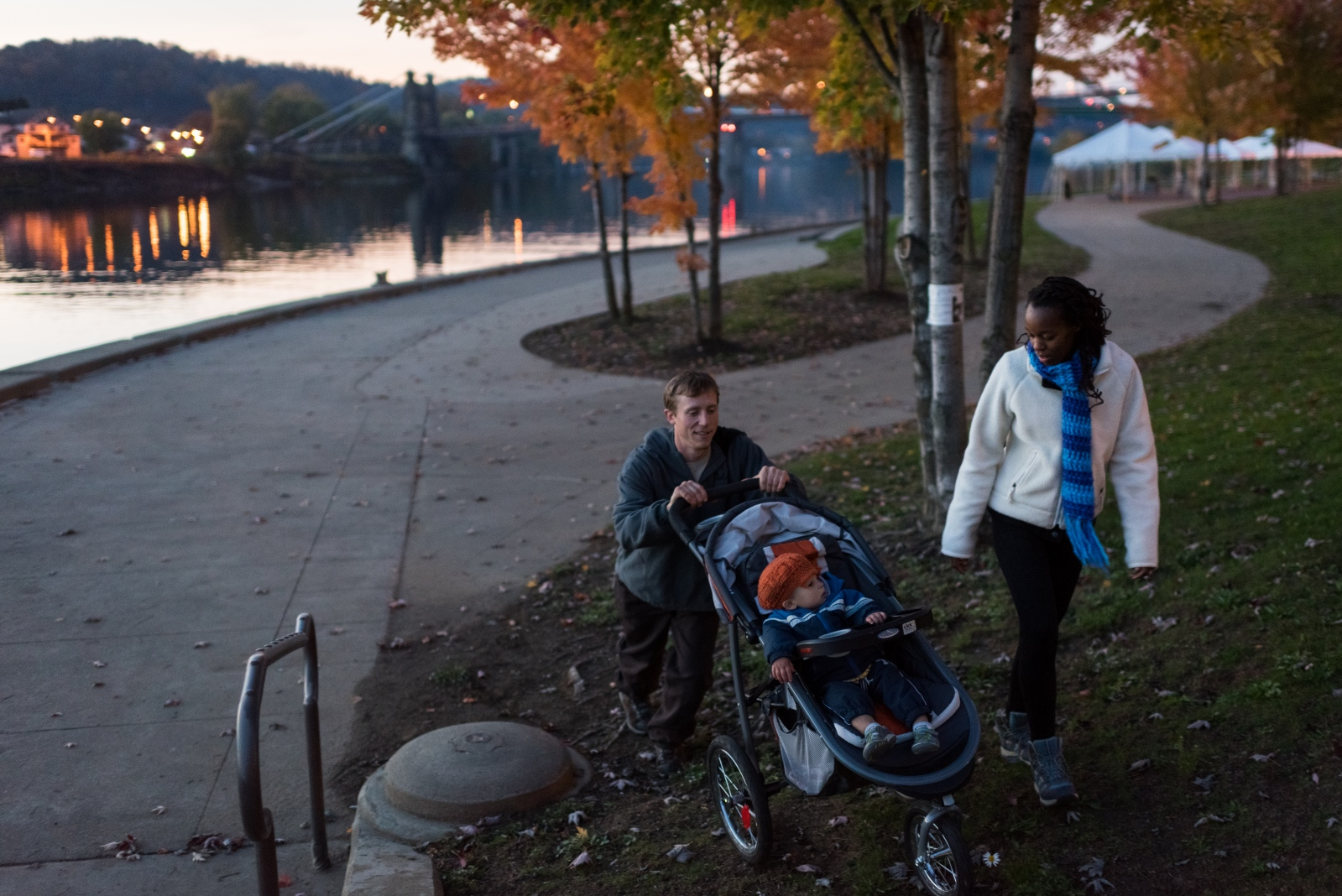 Danny Swan and Gloria Reina take an evening walk with their son, Sero. Wheeling's population has been declining for decades, with young people in particular leaving in large numbers. In the past few years, however, some young people have been moving in to put down roots, starting families and new ventures like Swan's Grow Ohio Valley. Some feel optimistic that this new small influx may help carve out a new direction for post-industrial Wheeling.