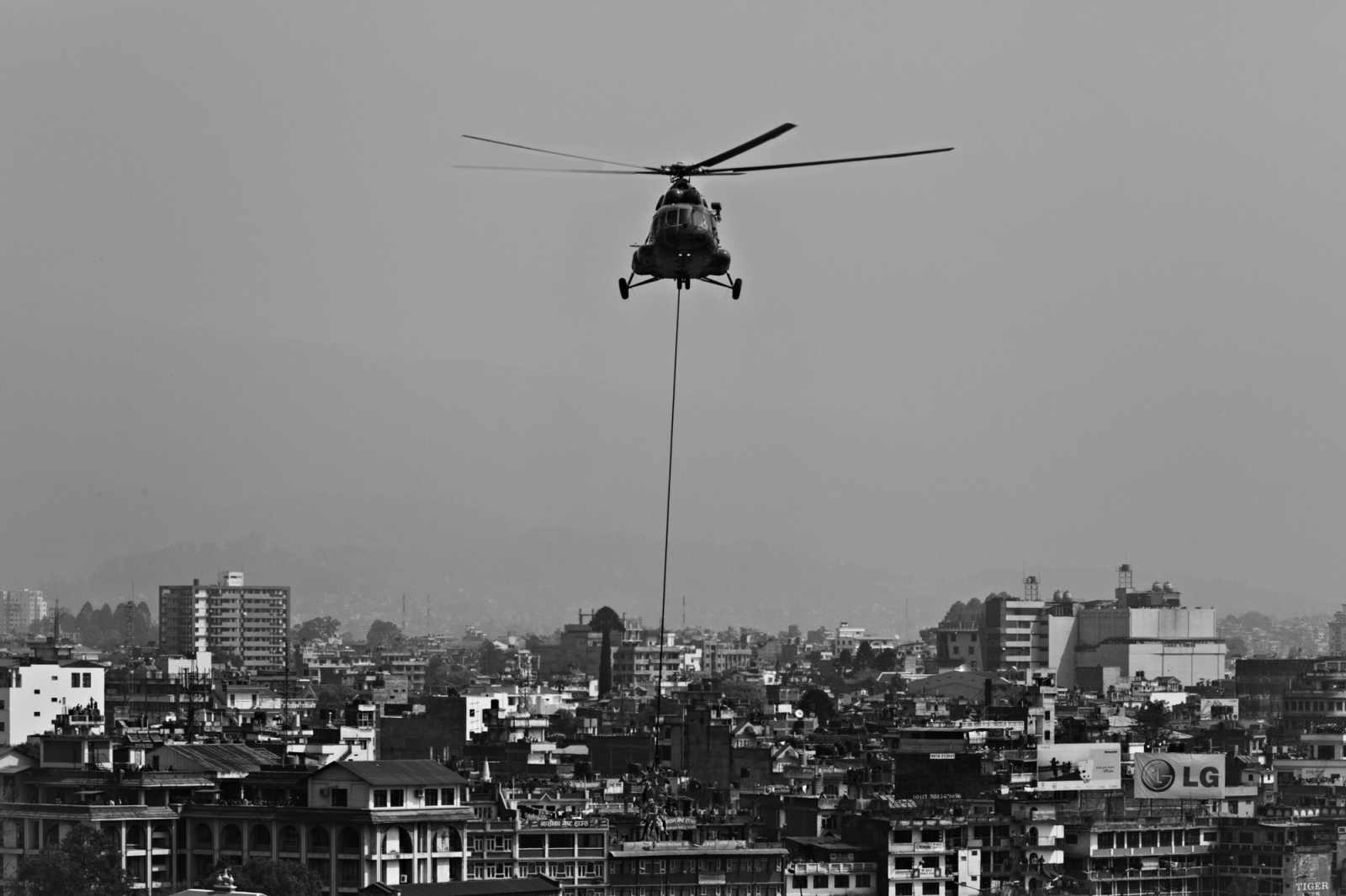 The Nepali military demonstrates their ability to airlift wounded soldiers out of areas where a helicopter can not land.