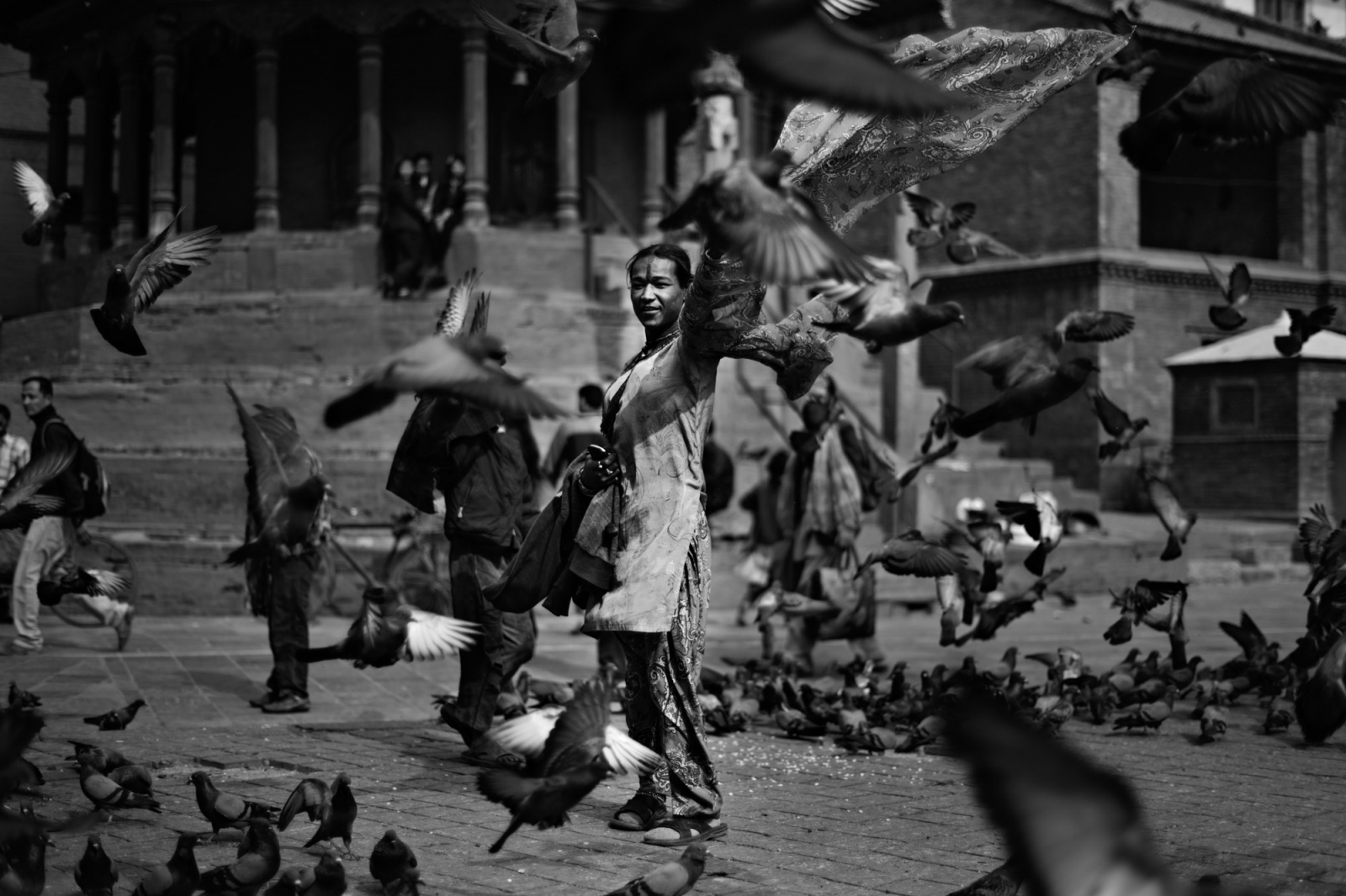 A woman walks through pigeons in Kathmandu's durbar square.