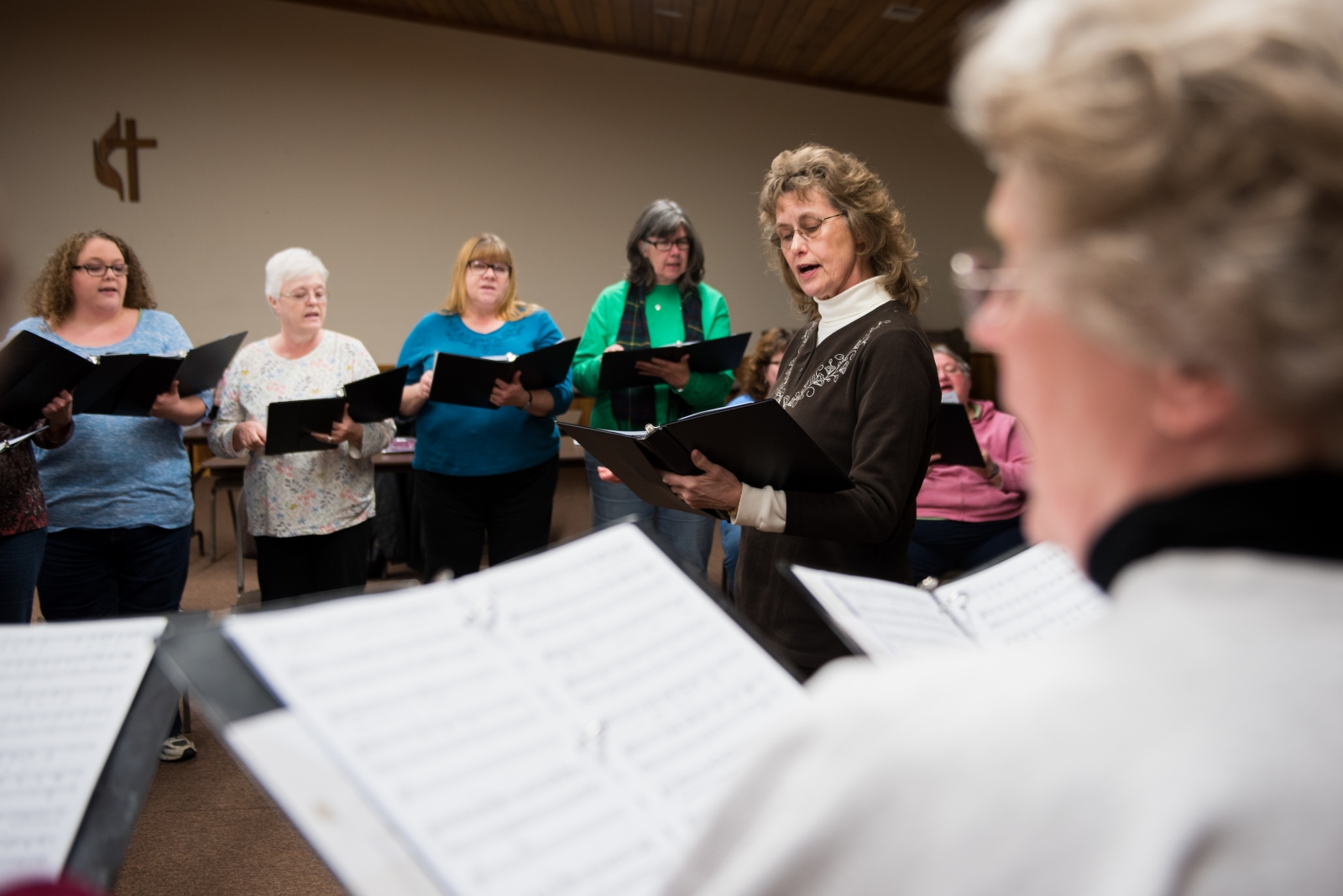 Martha Sue Matheny, director of the Unity Singers community Choir, leads a practice session at the Coolville United Methodist Church. (back row, left to right) Judy Reaser, Bonnie Putman, Marsha Cowdery, Kathy Elasky, Sharon Powell, and Katherine Riley sing together with (foreground) Shelba Lipscomb.