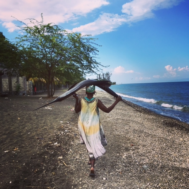 Along Grand Goave beach (Haiti), a woman is...