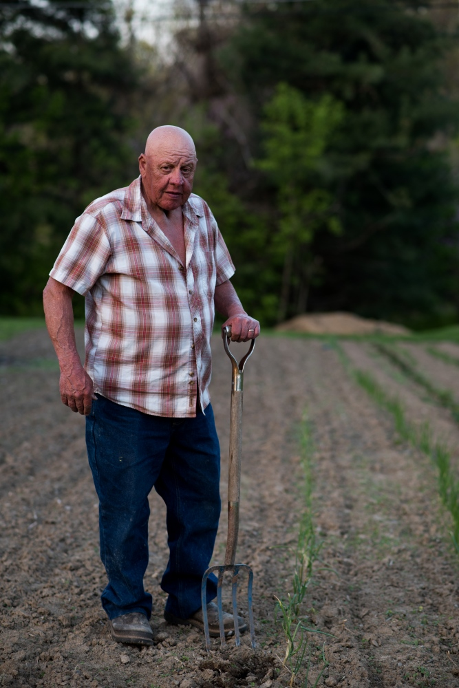 "Richard ""Smitty"" Smith pauses after finishing tilling his garden plot in preparation for planting vegetables at his home in Coolville in March 2015. Smith purchased the property in 1972 and has been planting in his garden every year since moving there."