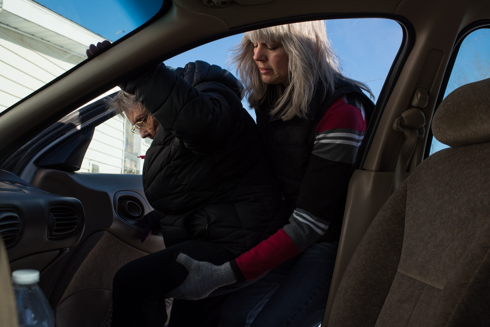 Roxanne Rupe, who serves as Coolville's librarian and is one of the most active members of the community, helps her mother-in-law, Mary Rupe, into Roxanne's vehicle in February 2015.Mary will spend the day with her son so that she won;t be alone at her own house.