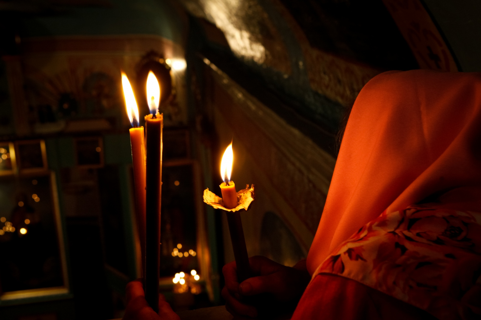 Candles lite during an early morning orthodox...