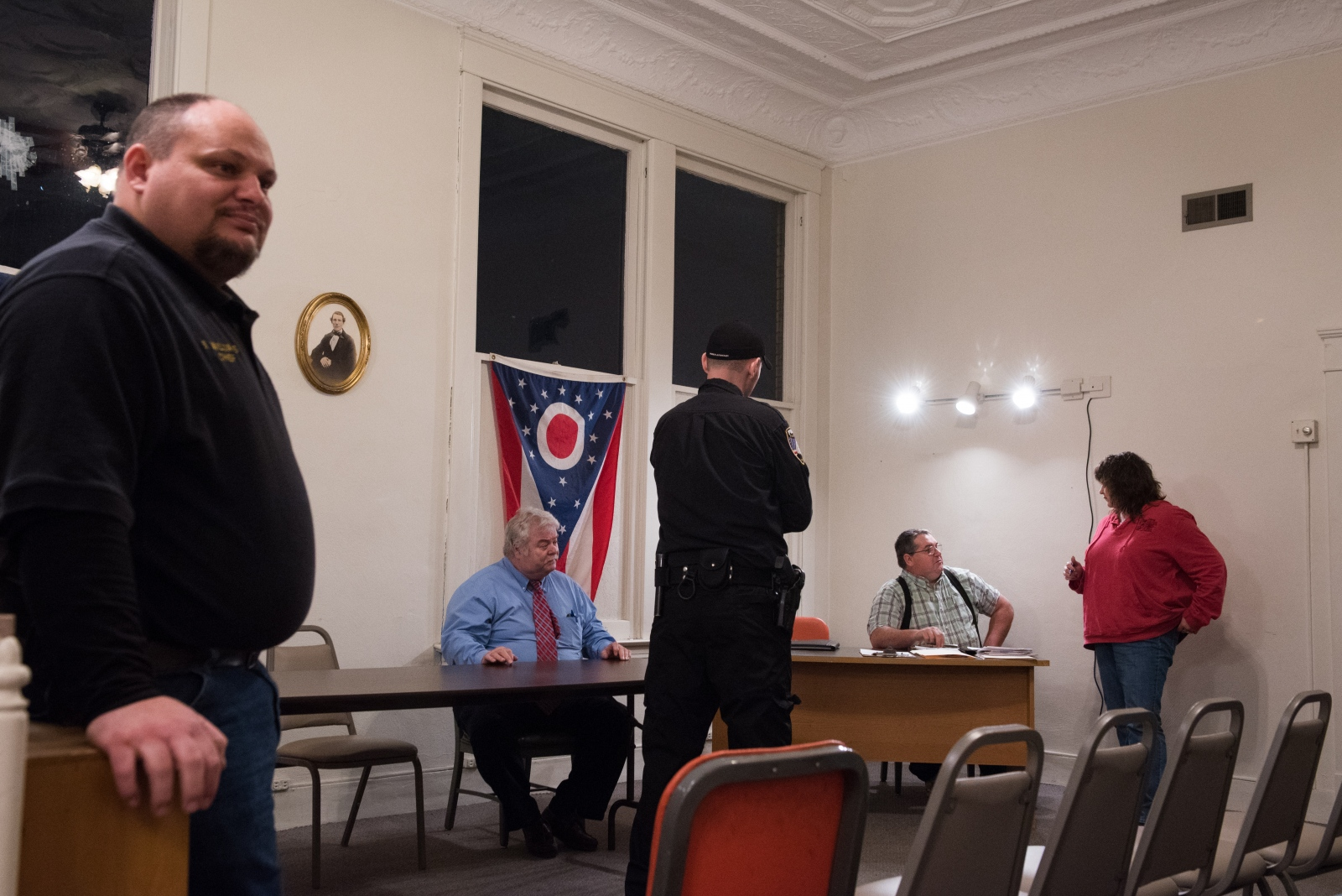 (left to right) Coolville police chief Steve Williams, solicitor Rick Hedges, officer Leif Babb, fiscal officer Jim Ford, and Michelle Hyer of Buckeye Hills-Hocking Valley Regional Development District wait for a town hall meeting regarding the implementation of a community sewer system to begin in Coolville, Ohio, in February 2014. A couple dozen residents packed into the room that night to voice their support for the town's voluntary fire department, which was asking that the town not begin charging them a water bill after the system was complete.  One reason why new businesses have not moved into Coolville is that the town has relied on septic tanks.