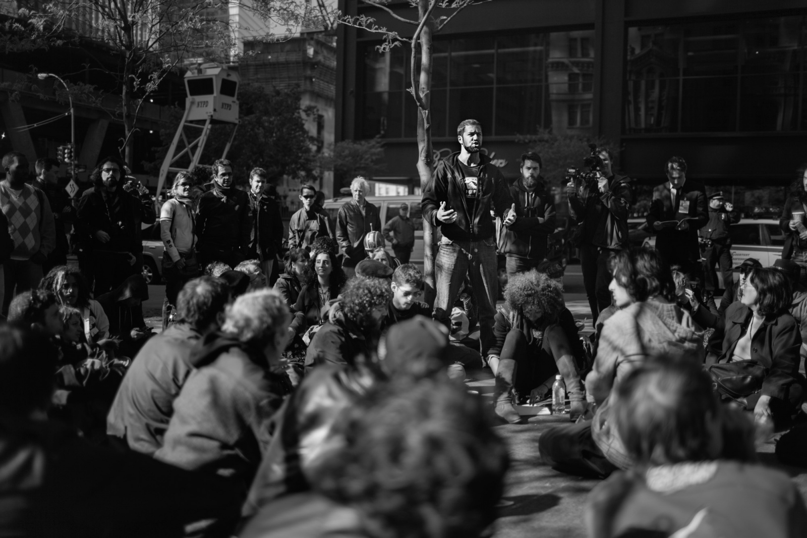 An OWS organizer gives instructions and guidlienes to protestors at Zuccotti Park.