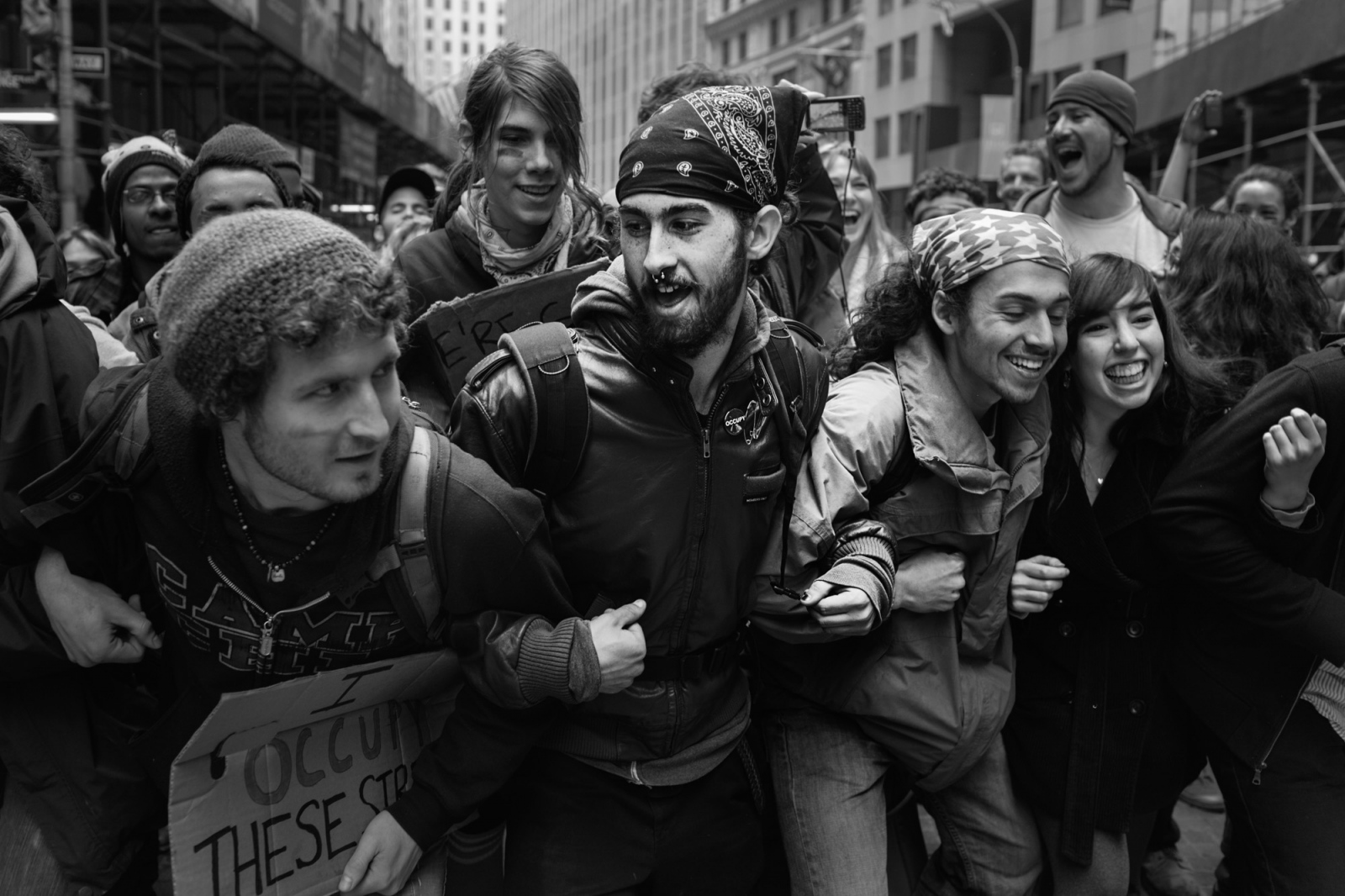 OWS protestors link arms to avoid people being singled out and arrested during a demonstration.