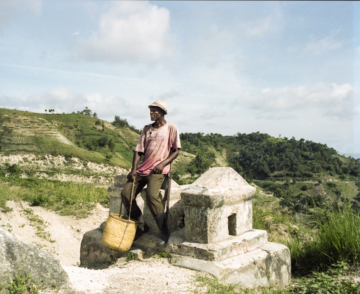 "Fondwa, Haiti. ""That grave has been built long time ago. Even before the road exists! My great-grandparents are resting there. Everybody enjoys to sit on it and appreciate the view."""