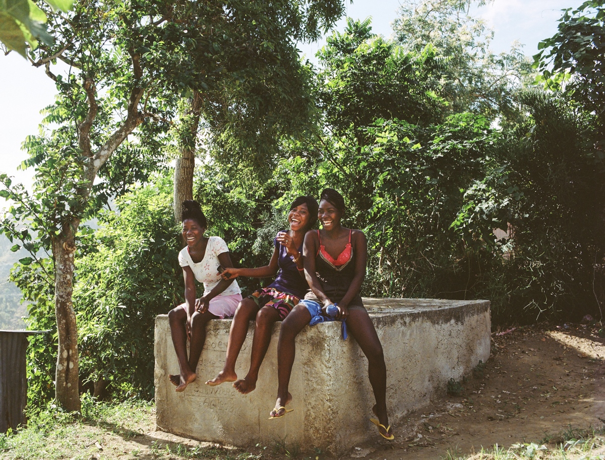 Grand Chemin section, Leogan, Haiti - Naika (18), Darlene (19), Dana (20) - We pretty enjoy to come here together and play cards.