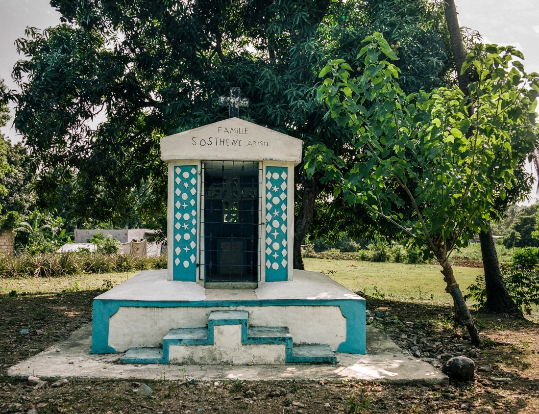 Haiti - In a field of Leogan area stands a family vault of the Haitian diaspora. Many of the families living abroad, buy land in order to ensure a return to their land and the eternal rest of their beloved ones