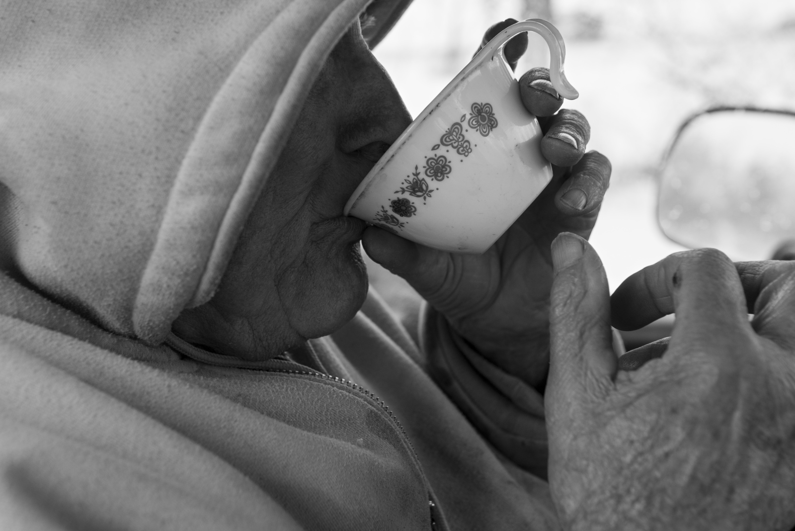 Dorsel Bibbee sips coffee from a ceramic mug he keeps with him in his truck before going out to help dig a grave at Fairview Cemetery near Coolville, Ohio, in February 2015.